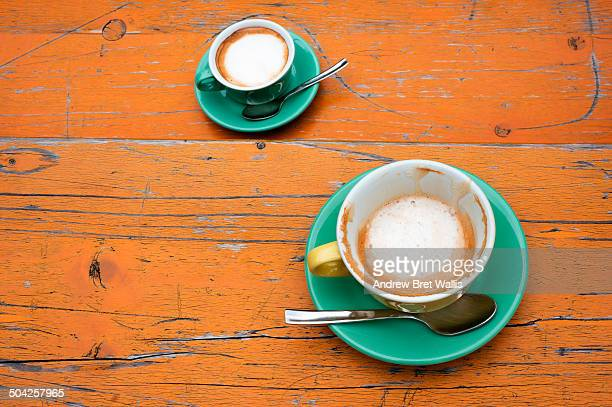 Two cups of cappuccino on a cafe' table