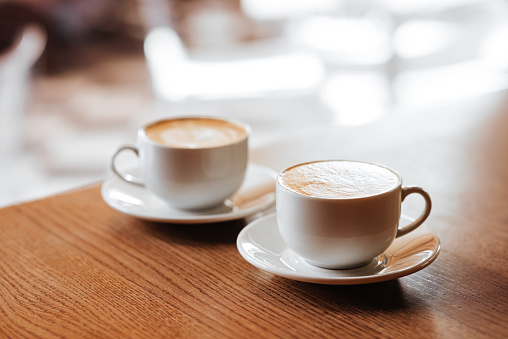 Two cups of cappuccino with latte art 954765056