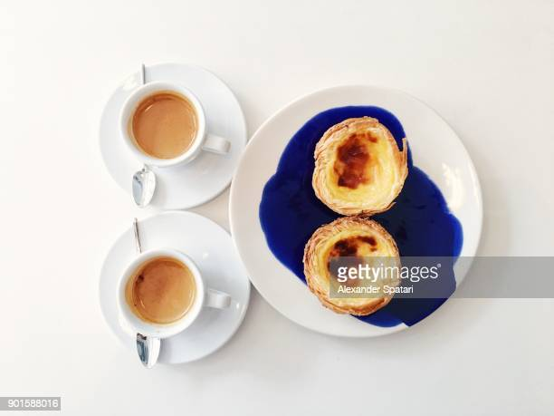 Two cups of coffee and pastel de nata on the table