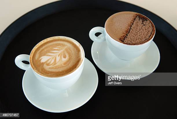 Two cups of coffee - cafe latte and cafe mocha - in a cafe. . Saucer saucers drink cafeteria cafeterias milky frothy foam design elegant