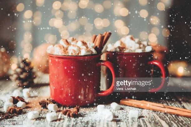 two cups of coffee with christmas decorations on dark wooden table - christmas decore candle stock pictures, royalty-free photos & images