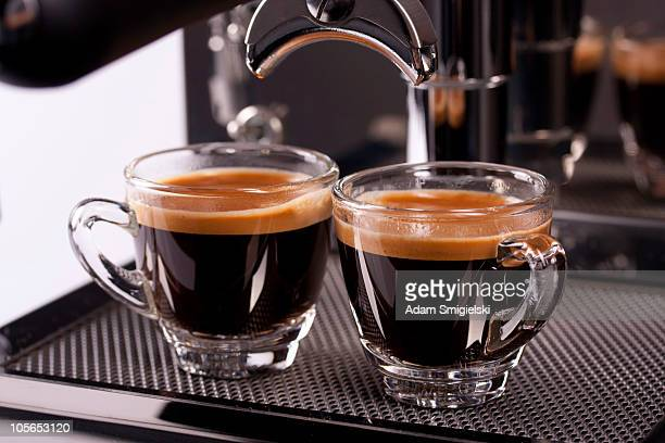 two cups of espresso shot with crema - espresso stock photos and pictures