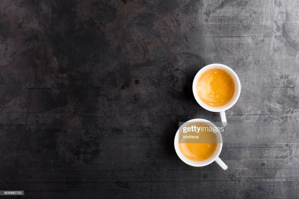 Two cups of fresh espresso on gray background : Stock-Foto