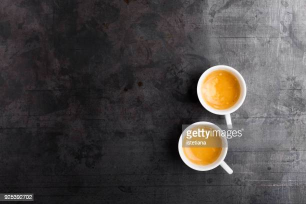 two cups of fresh espresso on gray background - espresso stock photos and pictures