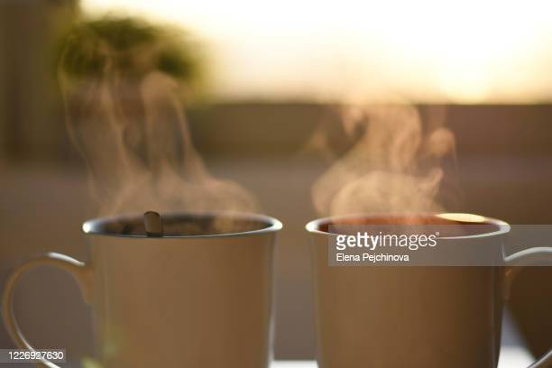 two cups of hot steaming coffee - morning photos et images de collection