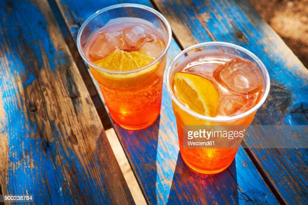 two cups of ice-cooled spritz with orange slice - disposable cup stock pictures, royalty-free photos & images