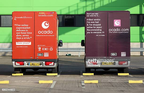 Two customer delivery vehicles stand outside the Ocado Group Plc distribution centre in Dordon UK on Friday Dec 16 2016 Ocado provides home delivery...