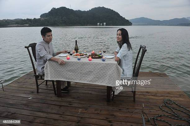 LIN'AN CHINA AUGUST 07 Two customers have meal on a floating restaurant at a scenic spot on August 7 2015 in Lin'an Zhejiang Province of China A...