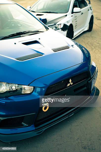 two customized mitsubishi lancer evolution x - mitsubishi group stock pictures, royalty-free photos & images