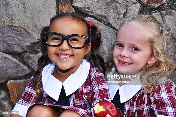 Two cute geeky school girls