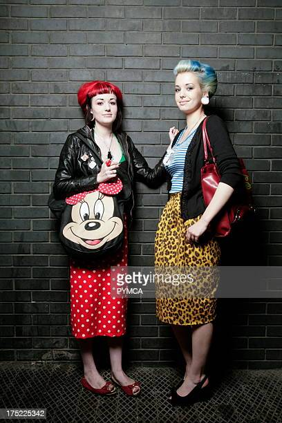 Two cute girls in retro styles with large ear lobe rings Outside Boombox Hoxton Bar and Kitchen Shoreditch London 2007
