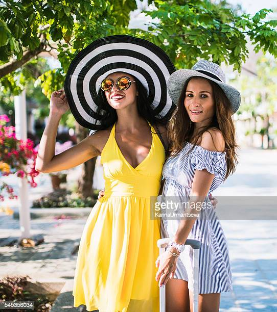two cute lady standing close to luggage - karina urmantseva stock pictures, royalty-free photos & images