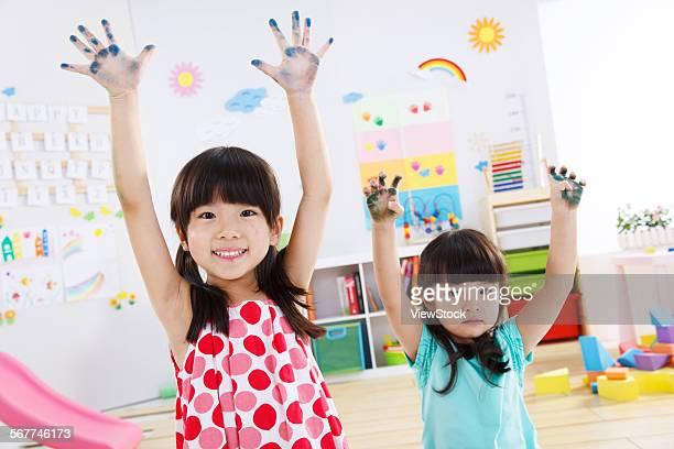 Two cute little girl in the kindergarten