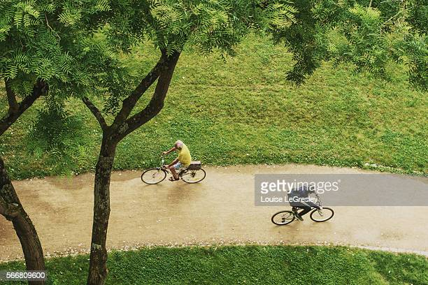 Two cyclers passing each other in a park