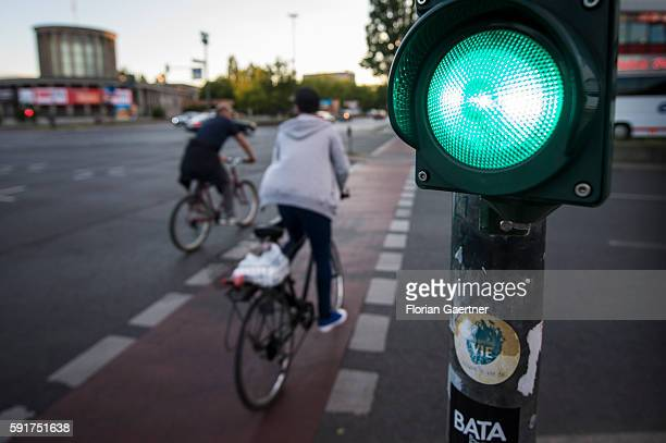 Two cyclists cross the street during green traffic light on August 17 2016 in Berlin Germany