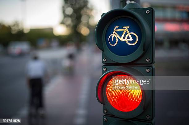 Two cyclists cross the street during traffic lights on August 17 2016 in Berlin Germany