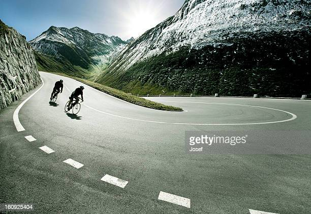two cyclists on mountain road