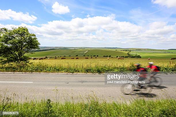 Two cyclists on rural round on South Downs