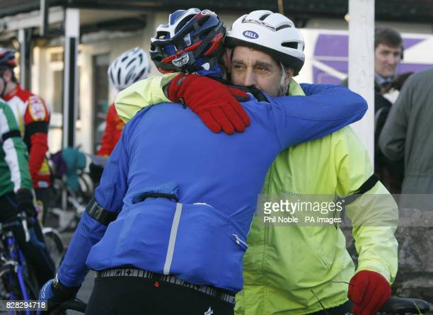 Two cyclists share an embrace before join the Rhyll Cycling Club on a club ride Sunday January 15 2006 a week on from a crash which killed four...