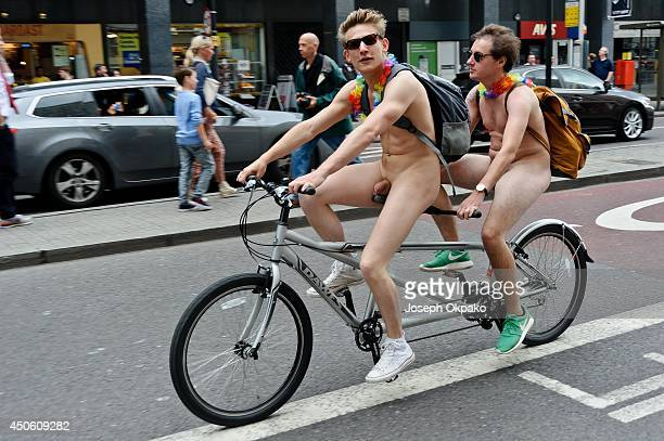 Two cyclists take part in the annual 'London World Naked Bike Ride' event in central London on June 14 2014 in London England