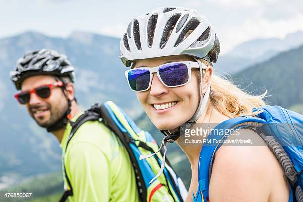 Two cyclists wearing cycling helmets