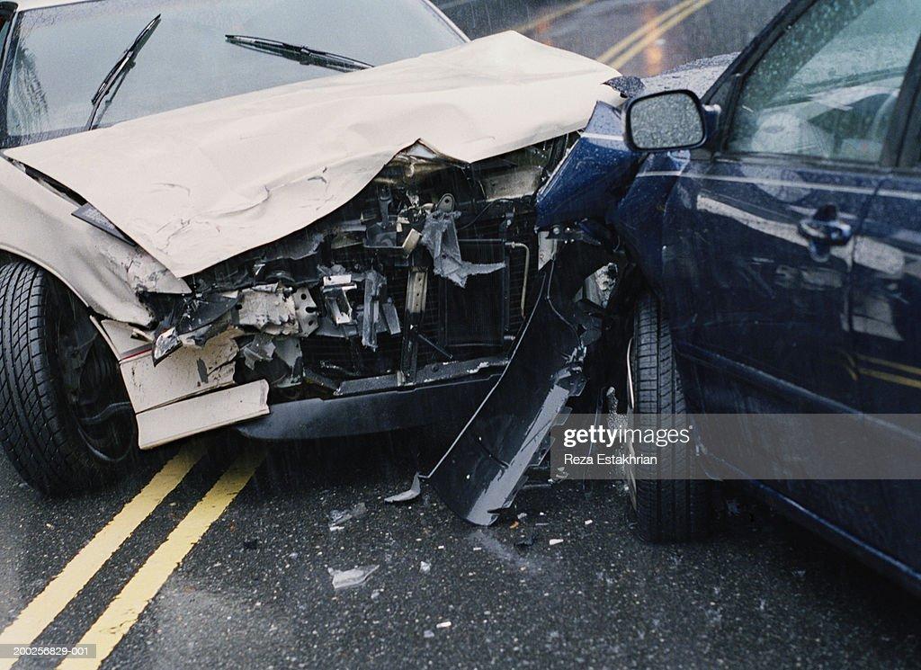 Two damaged cars after crash, close-up : Stock Photo