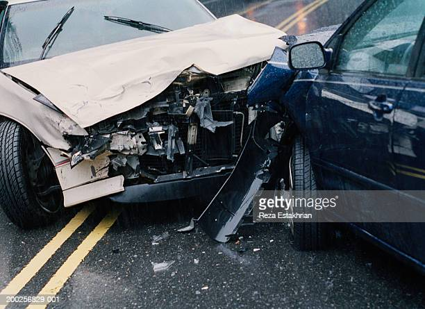 two damaged cars after crash, close-up - crash stock pictures, royalty-free photos & images