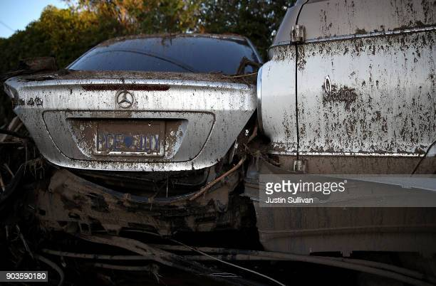 Two damaged cars sit on top of each other after a mudslide on January 10 2018 in Montecito California 17 people have died and hundreds hundreds of...