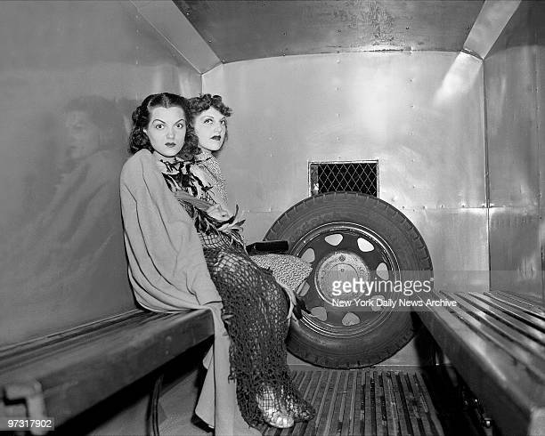 Two dancers at the 1939 World's Fair Dolores Irwin and Marge Berk sit in a patrol wagon after their arrest on the night of May 31 1939 the fourth day...