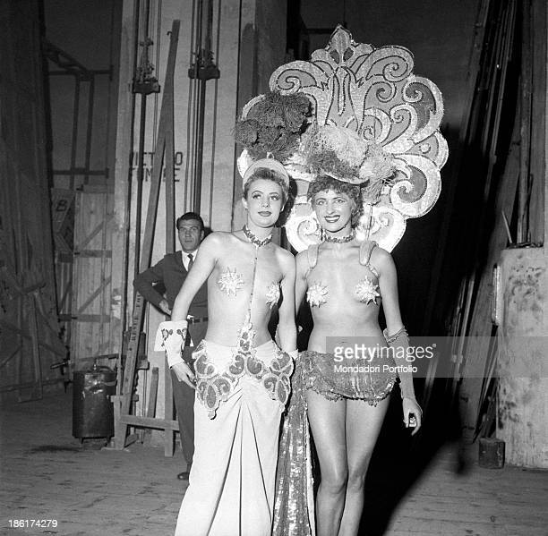 Two dancers belonging to the famous Folies Bergère the music hall theatrical company wellknown for its evening shows in the sign of the pleasures of...