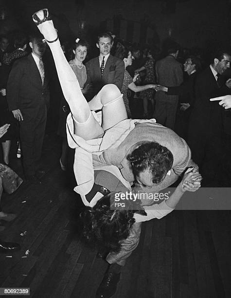 Two dancers cause a stir with a daring move on the dance floor circa 1940