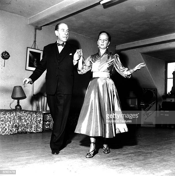 Two dancers demonstrate the Cha Cha Cha which originated in Cuba and is catching on in England
