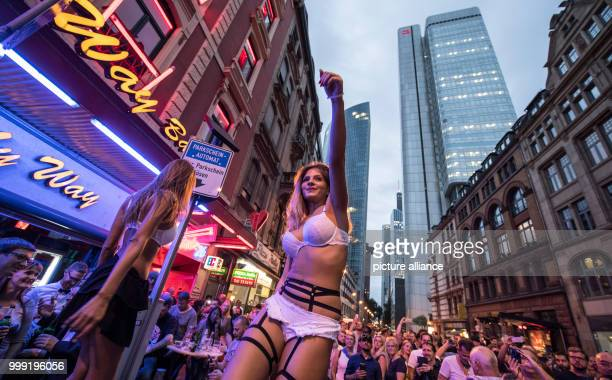 Two dancers entertain the public during Bahnhofsviertelnacht outside the My Way bar in the red light district of Frankfurt am Main Germany 17 August...