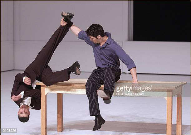 Two dancers from Pina Bausch Tanztheater Wuppertal perform 17 June 2003 in Paris' Theater de la Ville an erotic expressionist creation written and...