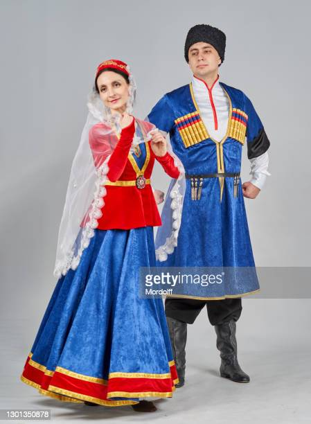 two dancers (male and female) in georgian traditional clothes are performing folk dance - georgian culture stock pictures, royalty-free photos & images
