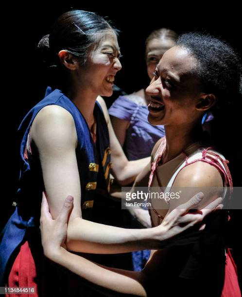 Two dancers offer encouragement to each other as they wait on stage before the curtain goes up for the World Premier of Northern Ballet's performance...