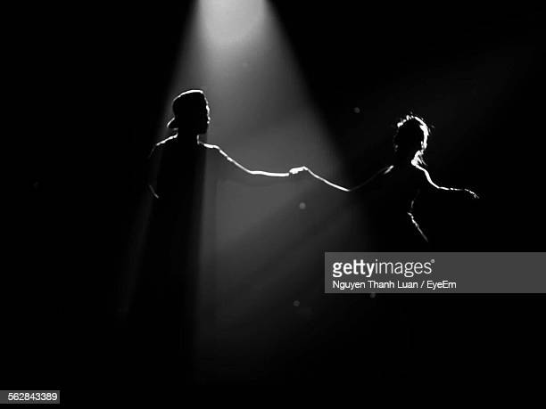 two dancers on stage during performance - back lit stock pictures, royalty-free photos & images
