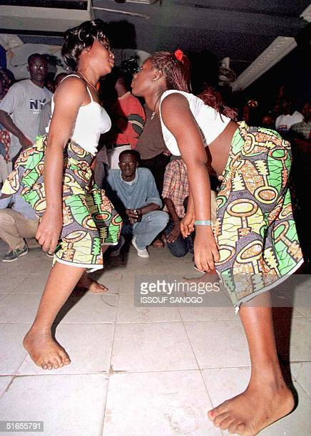Two dancers perform the 'Mapouka serre' or tight Mapouka in this photo taken 30 July at a night club in Abidjan The dance is competing with the...