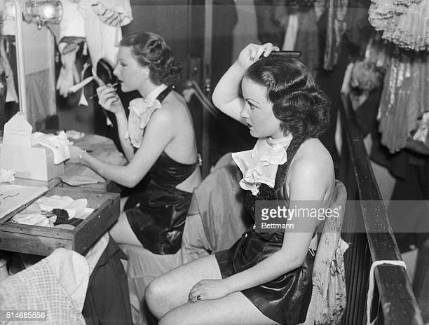 Two dancers prepare for the floor show at the Paradise Restaurant in New York | Location Night Club Dressing Room
