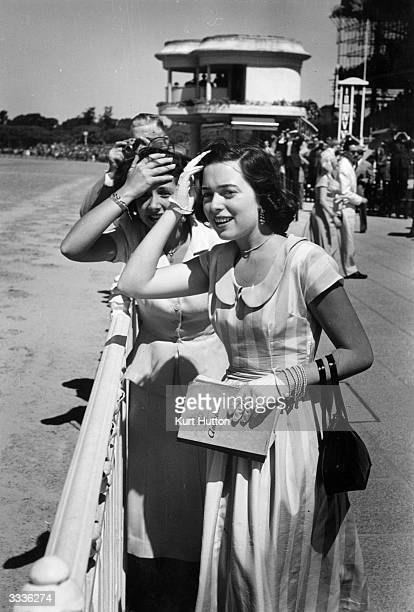 Two daughters of wealthy landowners attend the Palermo racecourse in Buenos Aires decked out in the latest European fashions Original Publication...