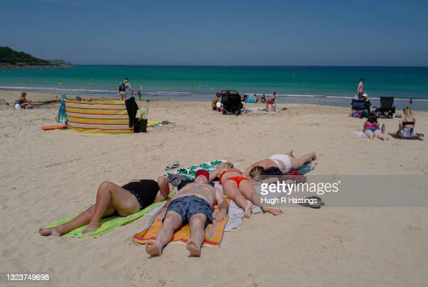 Two days after the end of the G7 Summit in Carbis Bay, a family of holiday makers relax on the beach on June 15, 2021 in Carbis Bay, England. UK...