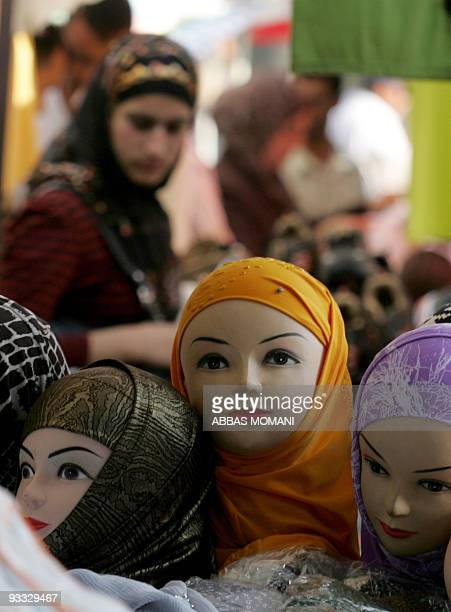 Two days before the start of the holy month of Ramadan a Palestinian woman shops for headscarves at the marketplace of the West Bank city of Ramallah...