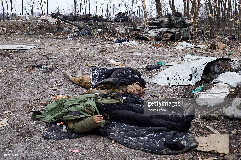 Two dead bodies of Ukrainian soldiers on the outskirt of the town on February 20, 2015 in Debltseve, Ukraine. The strategic railway town of Debaltseve is of under the control of pro-Russian rebel fighters, after Ukrainian Government forces began to withdraw from the town early on Wednesday, after heavy fighting.