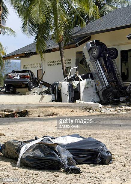 Two dead bodies of Western tourits lie outside the devastated Orchid resort along the shoreline of Khao Lak southern Thailand 29 December 2004 A...