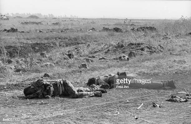 Two dead soldiers lying on the road on the Golan Heights during the Yom Kippur war