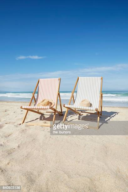 two deck chairs at beach - outdoor chair stock pictures, royalty-free photos & images