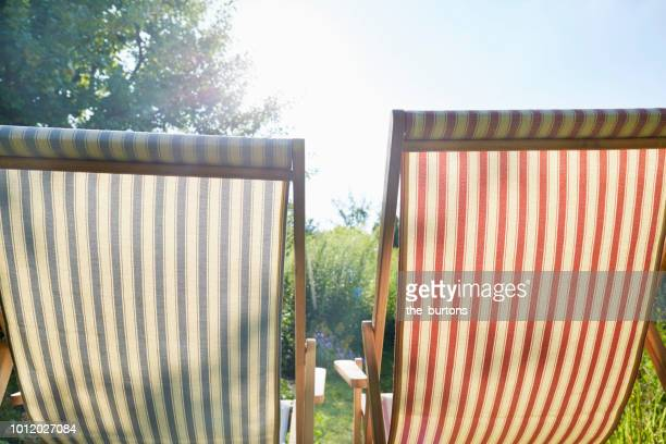two deck chairs in the garden - chaise longue photos et images de collection