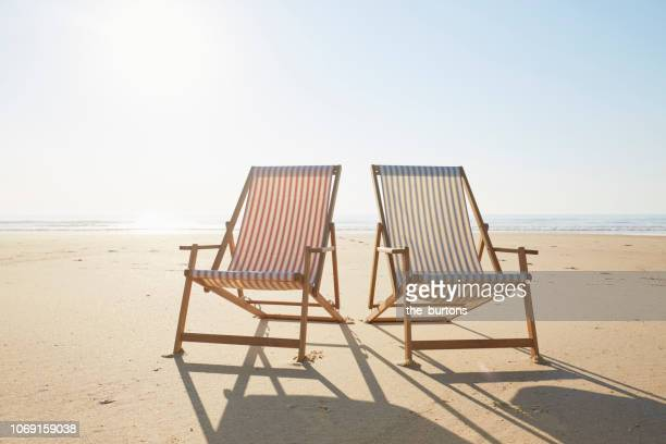two deck chairs on beach - outdoor chair stock pictures, royalty-free photos & images