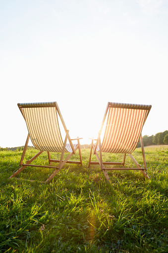 Two deck chairs on meadow - gettyimageskorea
