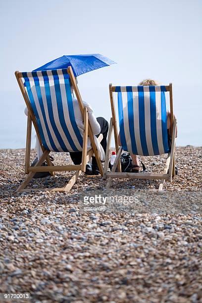two deckchairs on the brighton beach - brighton beach england stock pictures, royalty-free photos & images